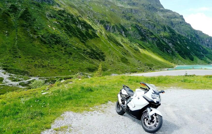 bmw motorbike next to lake