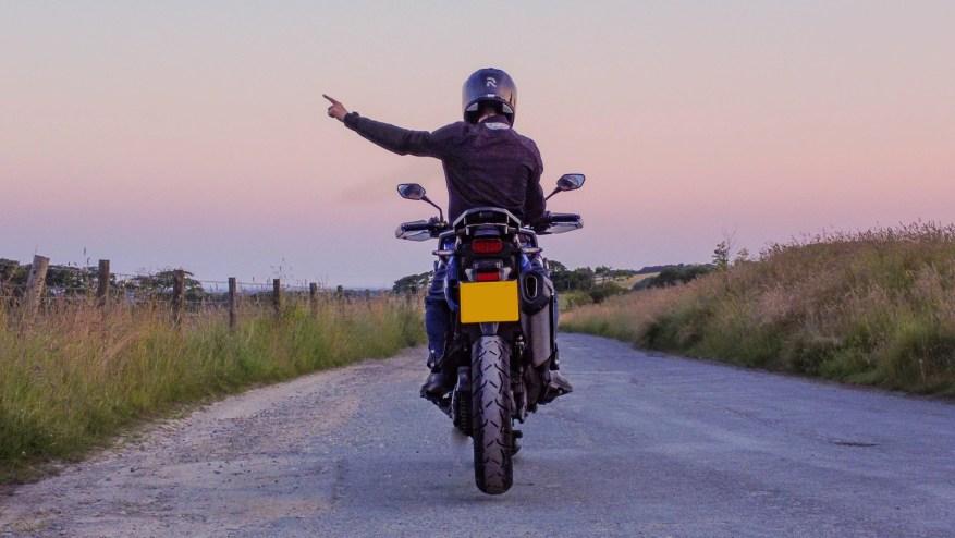 biker code hand signals - pull off next junction
