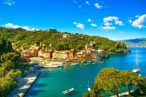 Portofino luxury landmark aerial panoramic view. Village and yacht in little bay harbor. Liguria, Italy