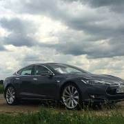 MR Tesla Model S in green field