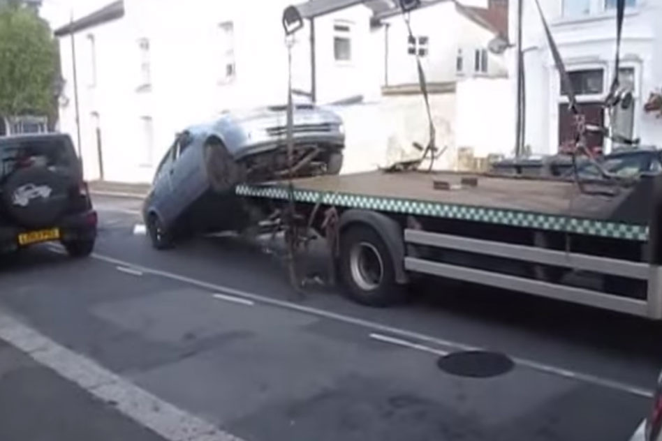 Illegally parked car jumps off transporter – and is caught on video