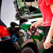 Motorist filling up with fuel