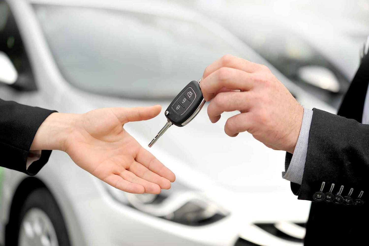 Handing over keys to a hire car