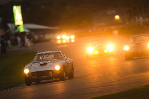 A Ferrari 250 GT SWB is chased by an Aston Martin DB4 GT as they race after the sunset. Taken by Nick Dungan for Goodwood