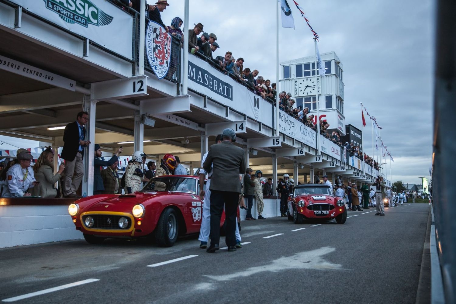 A Ferrari 250 GTO SWB and Austin Healey 3000 Mk1 in the pits for a driver change. Taken by Tim Brown for Goodwood