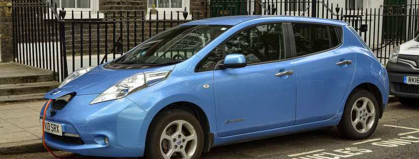Nissan Leaf using an on-street electric car charging point