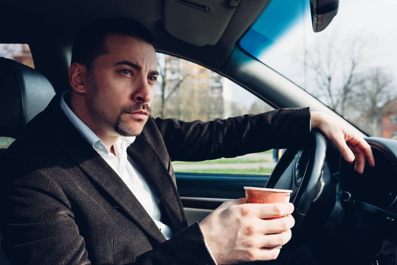 Distracted man driving