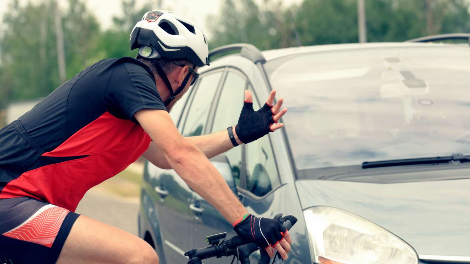 Cyclist arguing with a driver
