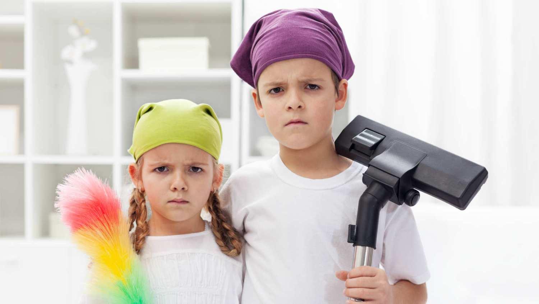 Children tidying bedroom