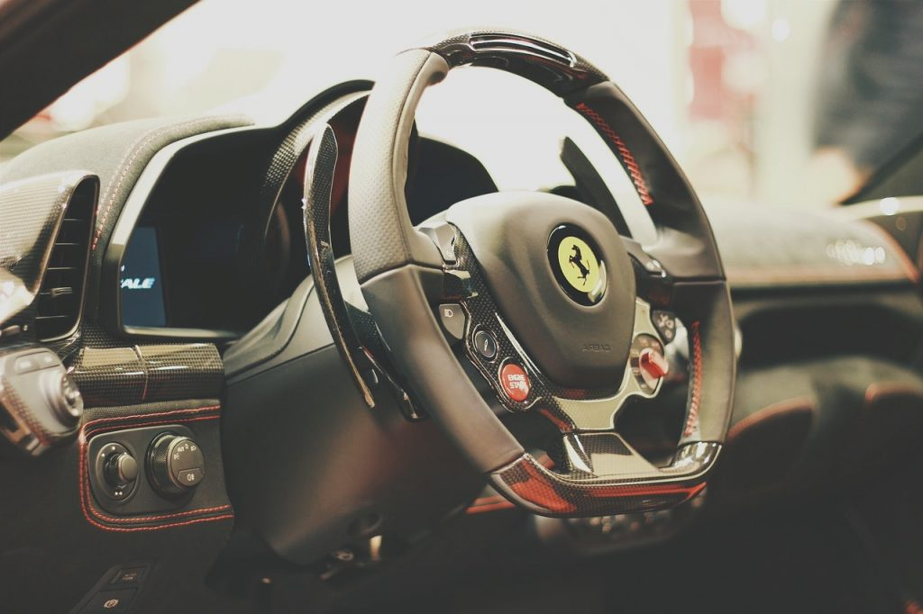 Ferrari steering wheel connected through a power steering system to the wheels.