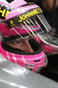Jenson Button sits in his car.