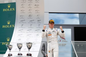 2015 GP2 Series Round 4.  Red Bull Ring, Spielberg, Austria.  Saturday 20 June 2015.  Stoffel Vandoorne (BEL, ART Grand Prix) celebrates his win on the podium. Photo: Sam Bloxham/GP2 Media Service  ref: Digital Image _G7C5298
