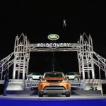 bear-grylls-rapels-from-a-helicopter-as-he-arrives-at-the-global-unveiling-of-the-new-land-rover-discovery-at-packington-hall-solihull-uk