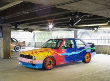 "© BMW AG / ""ART DRIVE! Die BMW Art Car Collection 1975-2010"" in London, 21. Juli – 4. August 2012. Von links: Michael Jagamara Nelson, BMW Art Car, 1989 - BMW M3 Gruppe A Rennversion, Ken Done, BMW Art Car, 1989 - BMW M3 Gruppe A Rennversion"