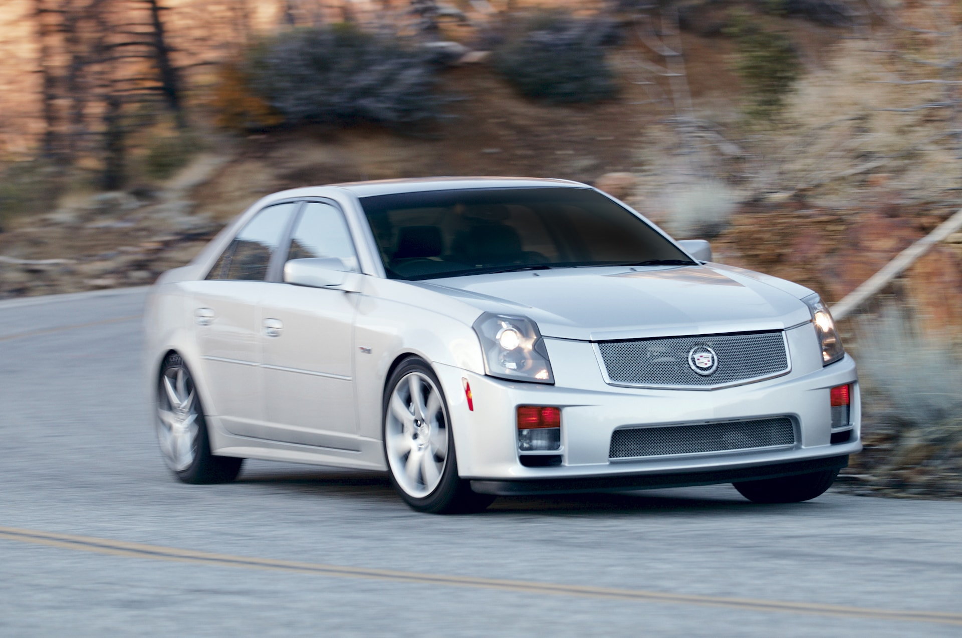 2005 Cadillac CTS V front three quarter in motion