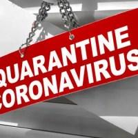 "Red sign hanging on glass door that read ""Quarantine Coronavirus"""