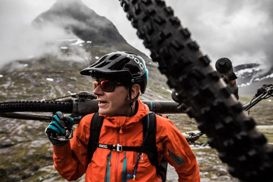 hike-a-bike with one hand, hike a biking is part of our mountain bike tricks blog.