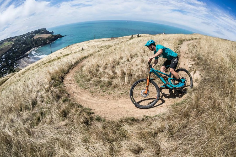 Yeti EWS race Jubal Davis riding the Porthills of Christchurch, part of our mountain bike tour New Zealand and as seen in our best mtb tricks blog.