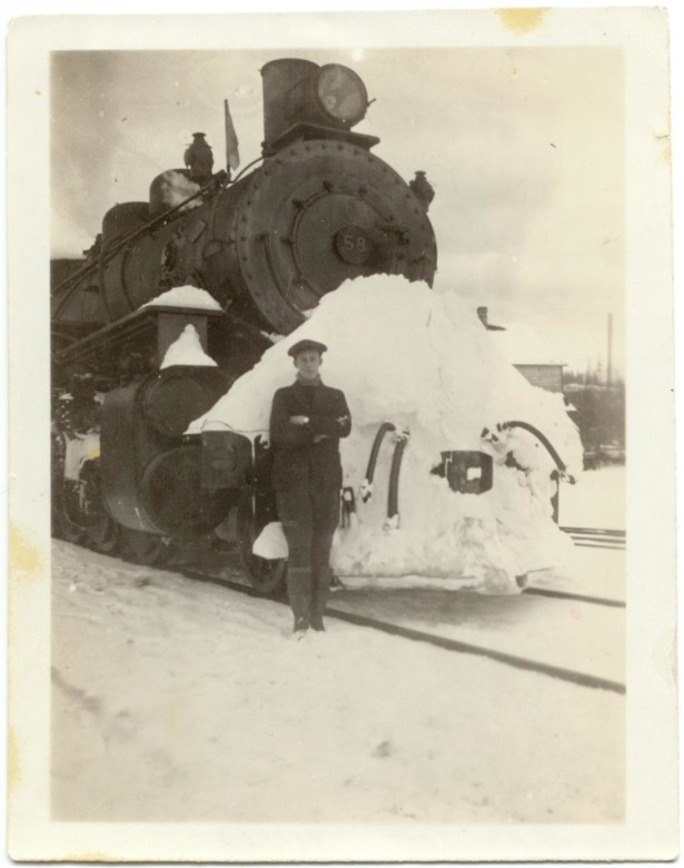 Reg Shurie in front of a PGE train. Note how the 'cowcatcher' on the front acted as a snow plow. 1920s. Photo courtesy Whistler Museum.
