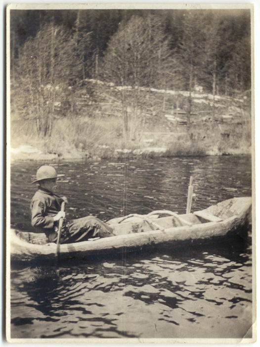 Unidentified paddler in handmade dugout canoe. Photo courtesy Whistler Museum.