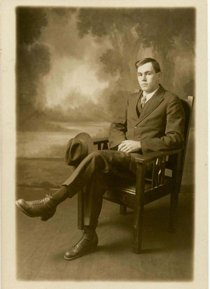"""Studio portrait of Frank Tapley seated in a chair, 22 years old. Annotation on verso: """"Frank 1920"""". Photo courtesy Whistler Museum."""