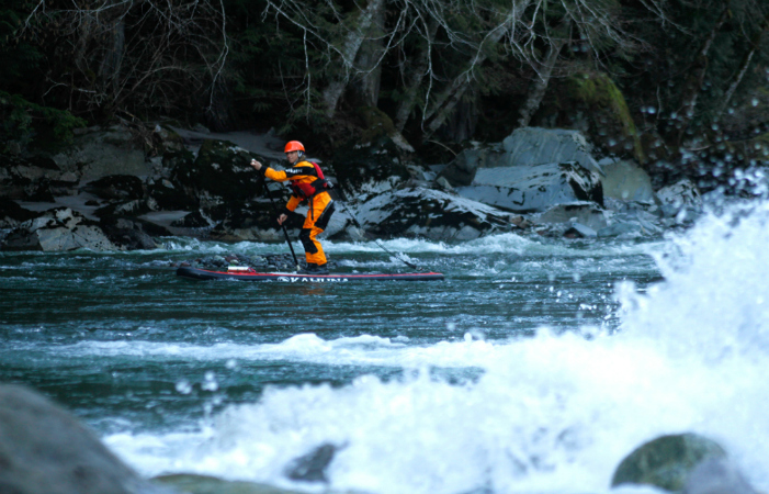 Karine Choiniere sending down the Chekamus river feb winter day in Squamish