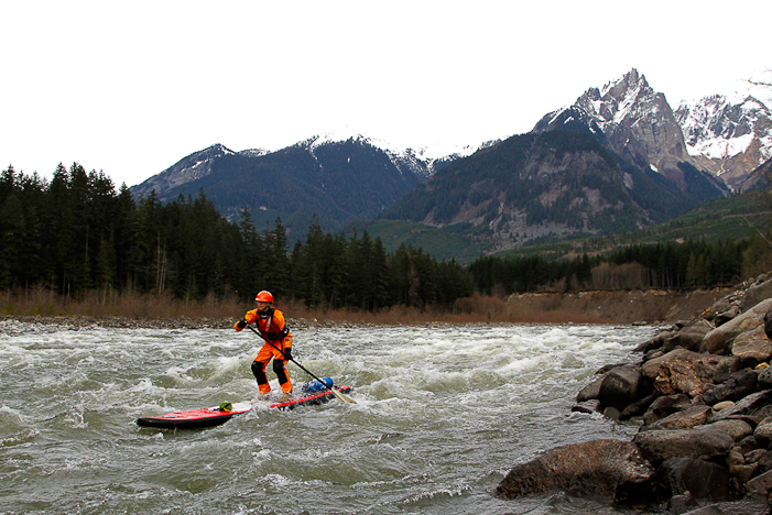Karine enjoys the many incredible views while sending rapids on the Elaho. JIMMY MARTINELLO PHOTO.