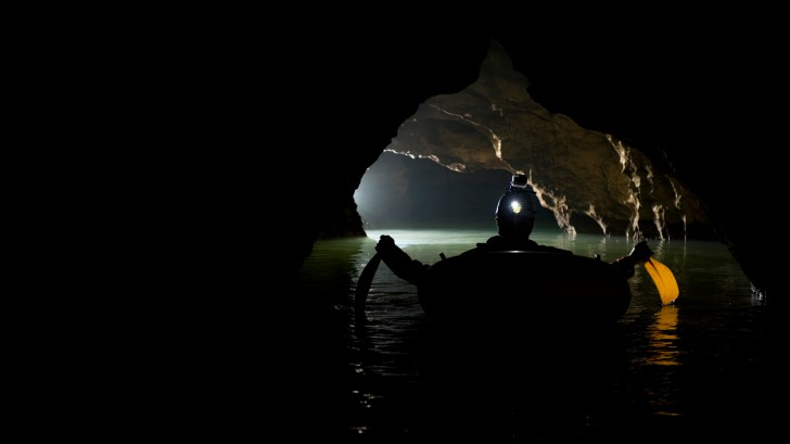 Fabien Hoblea, from CNRS exploring a new cave passage in Fengshan, Guangxi province, China
