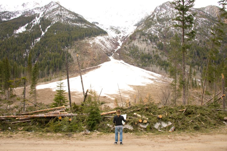 Skier Chad Sayers contemplates the remains of one of the many destructive avalanches of winter 2013-2014 in the Jumbo area.