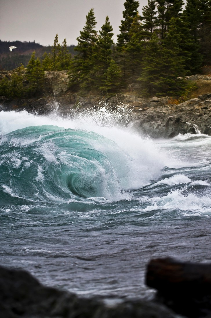 Powerful Lake Superior waves crash at the mouth of the Michipicoten River in Ontario Canada during a fall storm.