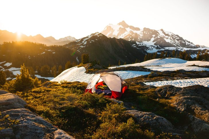 tent at sunrise in the mountains