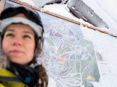 Looking at the ski run sign