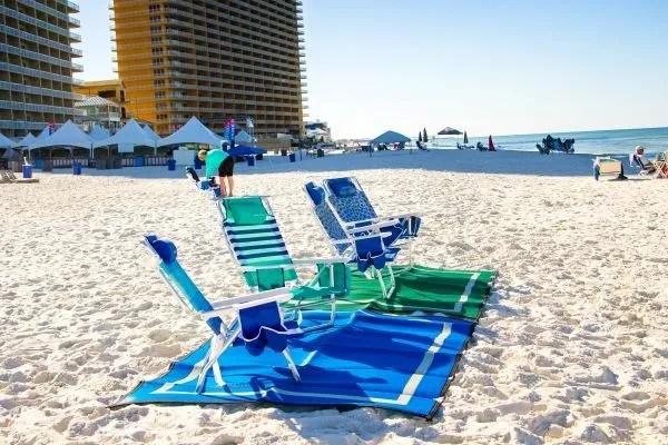 beach chairs on beach mats at ocean