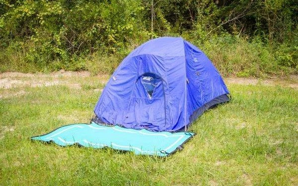 blue tent with teal colored camping map in front