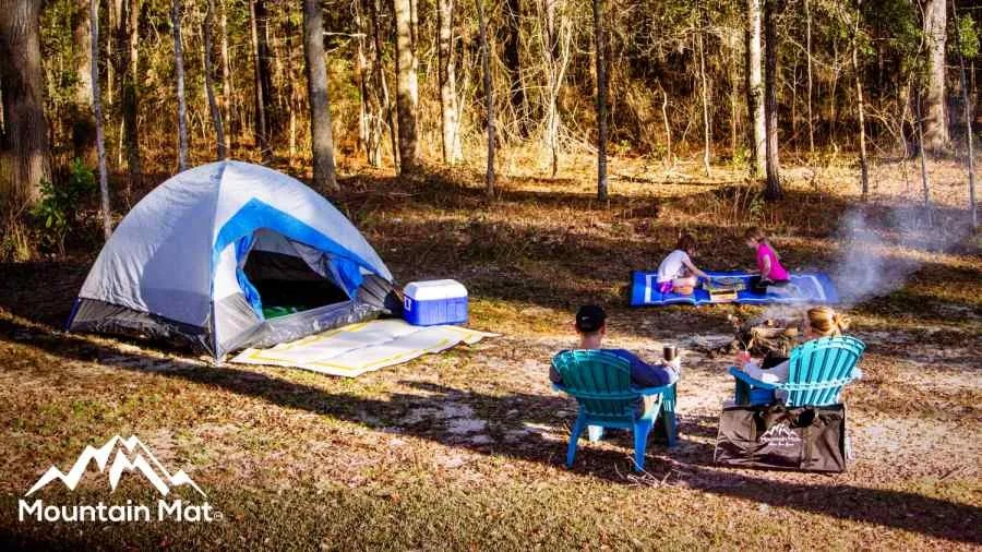 family at a campsite with mountain mats