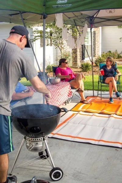 Football tailgate party with orange and white tailgater rugs size 5x7