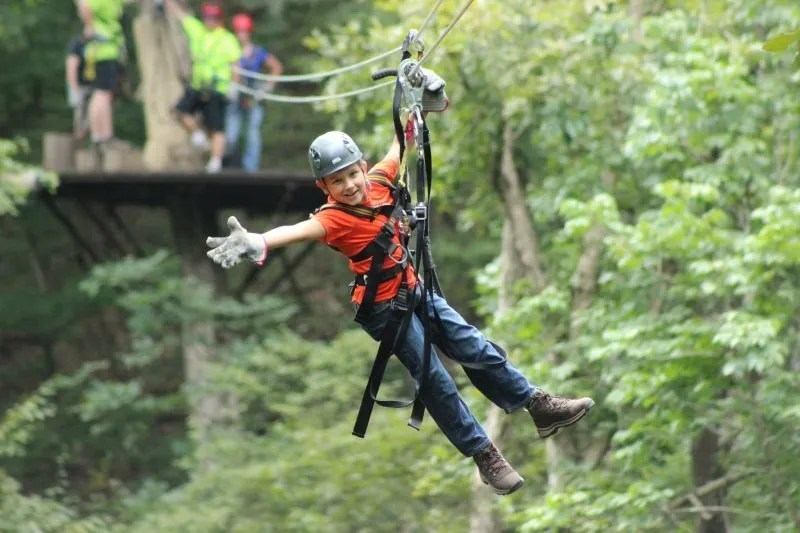 kid on a zipline at Shenandoah River Park