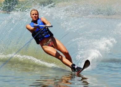 Beautiful Woman Waterskiing On A Lake