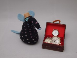 Winston Vaark has his suitcase open, displaying his stock of watches