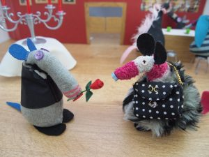 Dim presents Matilda with a single red rose