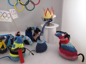 The cauldron lights up with paper flames