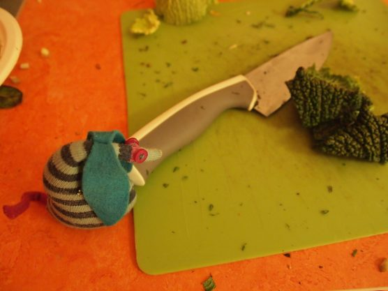 Ofelia chops some cabbage with a big knife