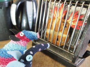 Ratvaark and Winston look on in horror as the bun starts to catch fire