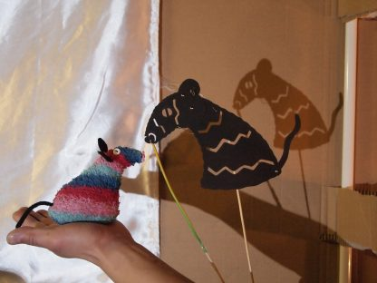 The paper shape is a Ratvaark shaped shadow puppet