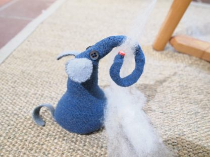 Ernest holds the wool roving