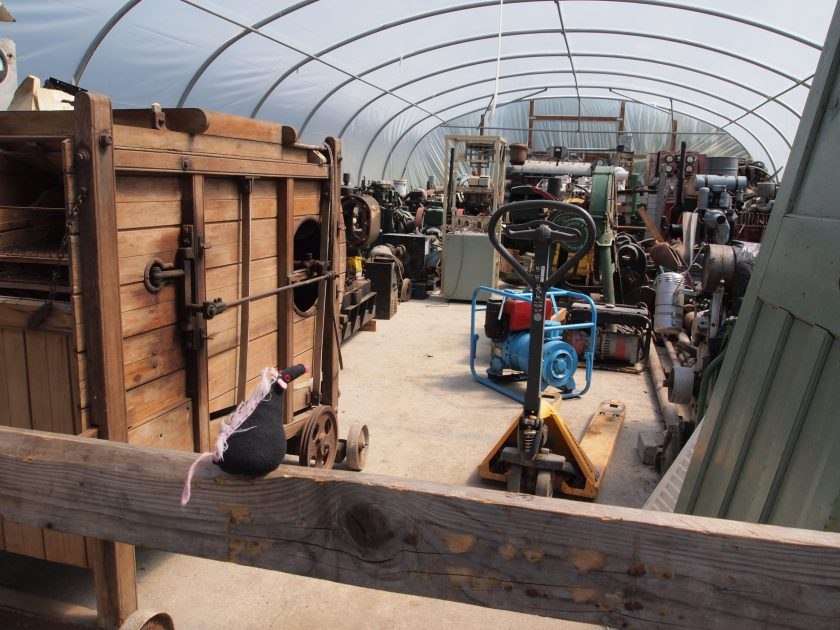 Fury peers into a polytunnel full of various equipment