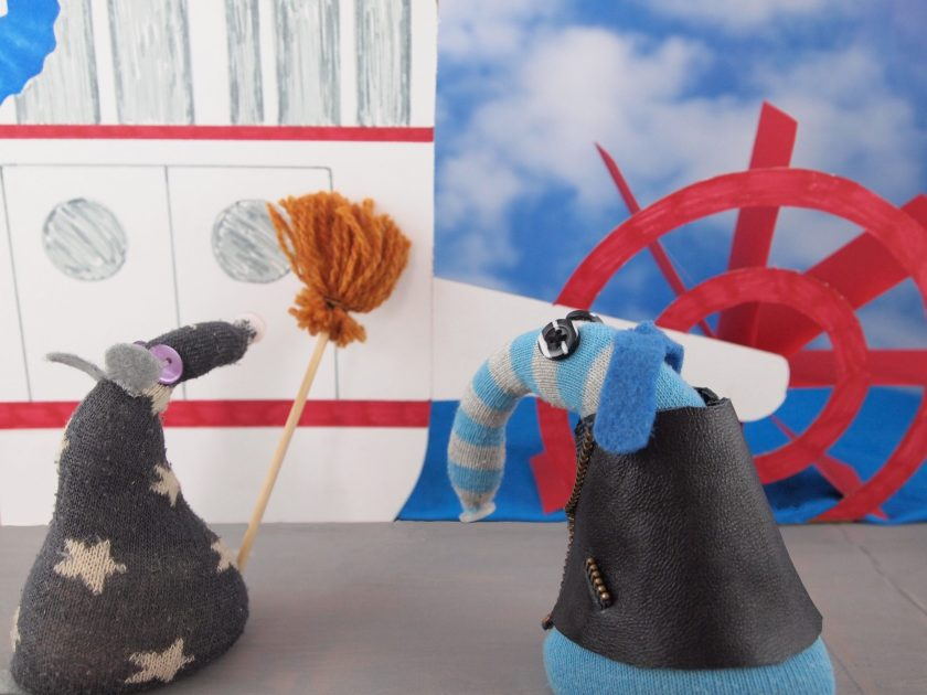 Arnold looks at a Mississippi Paddle Steamer, which is being mopped by Vincent
