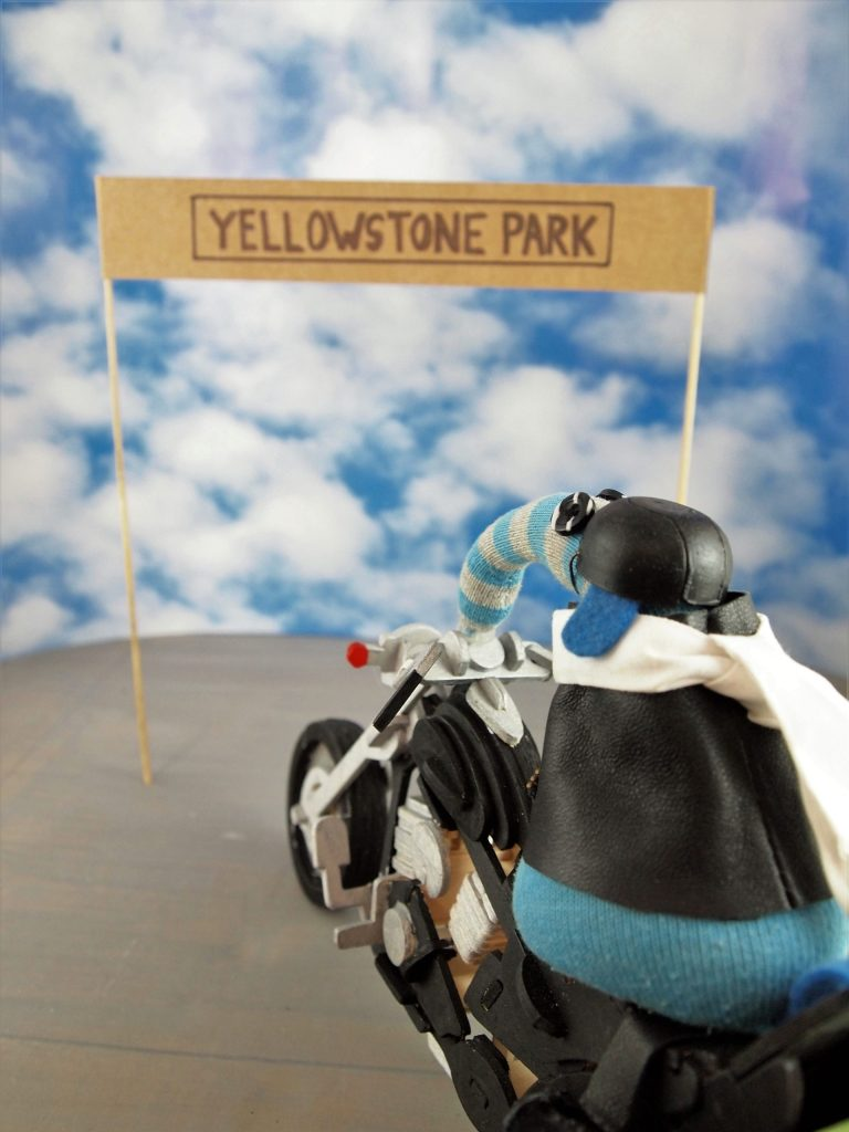 Arnold arrives at a sign reading Yellowstone Park