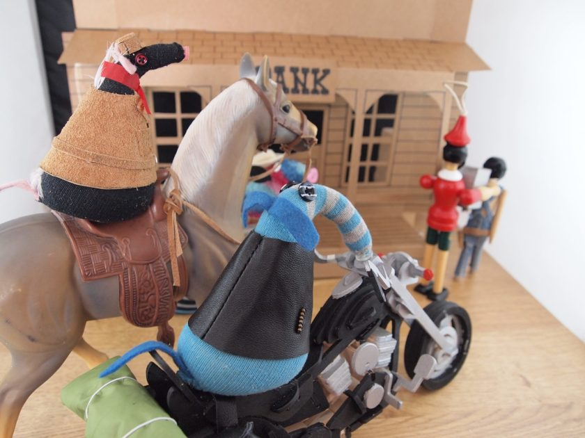 Arnold has jumped onto his bike, and Fury rides a horse with a Western saddle