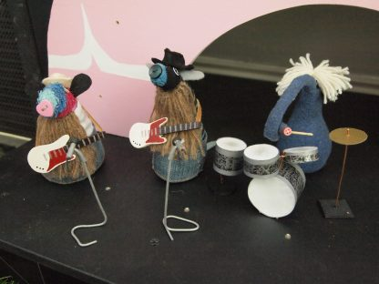 ZZ Top are played by Ratvaark, Hypno and Ernest. Ratvaark and Hypno have long beards.